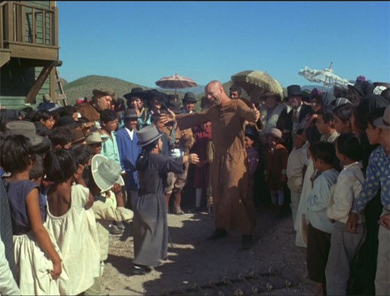 "El Topo, reborn as a beggar, entertains the crowd with his companion, ""The Small Woman"" (Jacqueline Luis)."