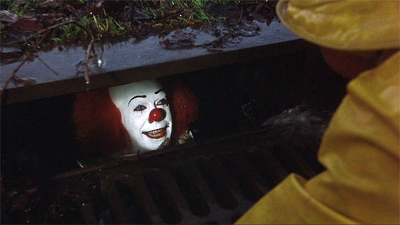 "Tim Curry as Pennywise the Clown promises little Georgie that ""everything floats down here."""