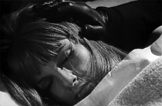 Melissa (Agnès Spaak) is visited at night by the walking corpse of her dead father.
