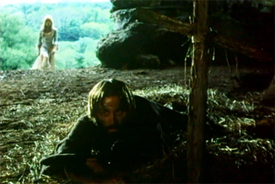 Ambrosio, in exile, is visited by the sorceress Mathilde (Nathalie Delon).
