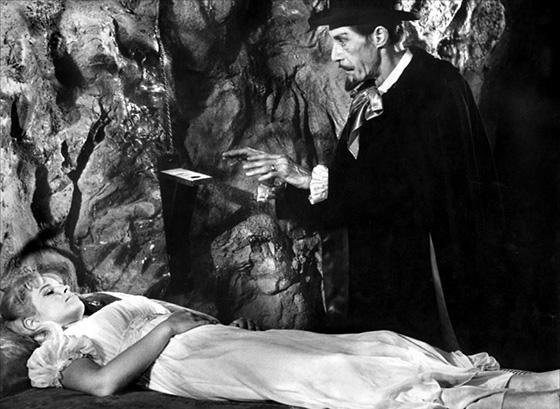 The vampire (John Carradine) mesmerizes Betty Bentley (Melinda Plowman) in an abandoned mine.