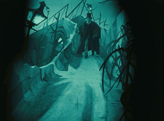 Caligari runs from the police through the village of Holstenwall.