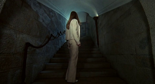 Christina (Christina von Blanc) innocently explores a haunted mansion.