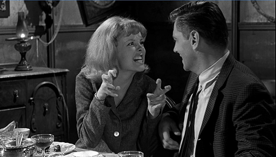 Ann Morris (Mary Mitchel) and Peter Howe (Quinn Redeker) discuss monsters over dinner.
