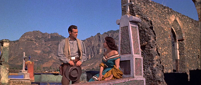 """""""The Beast of Hollow Mountain"""": Jimmy (Guy Madison) has a liaison with the lovely Sarita (Patricia Medina) in a Mexican graveyard."""