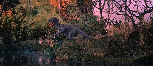 """The """"Beast of Hollow Mountain"""" stomps through the swamp."""