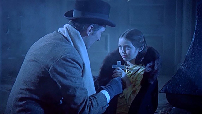 Van Helsing comforts Tania (Janine Faye) in a graveyard stalked by a vampire.