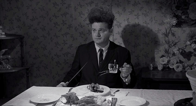 Henry Spencer (Jack Nance) endures a traumatic dinner with his girlfriend's family.