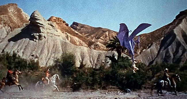 """A Pteranodon hoists a cowboy off his horse in """"The Valley of Gwangi."""""""