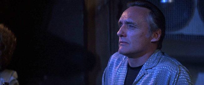 "Frank Booth (Dennis Hopper) watches Dorothy perform ""Blue Velvet"" at the Slow Club."