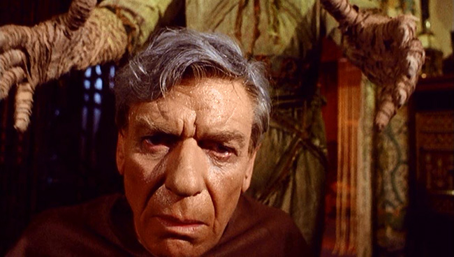 The mummy stalks Sir Basil Walden (André Morell).