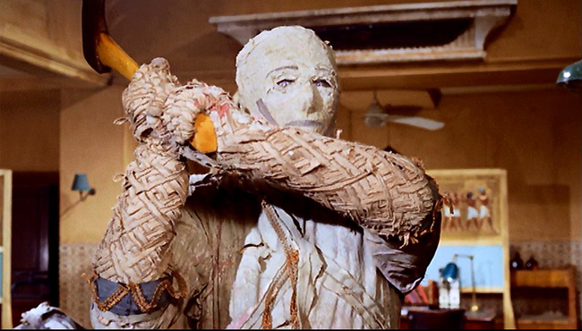 Prem (Eddie Powell) with axe.