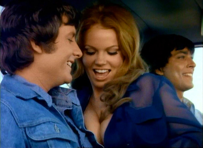 Clint Ramsey (Charles Pitts) accepts a ride from the perverse couple SuperCherry (Colleen Brennan) and Cal (John Lazar).