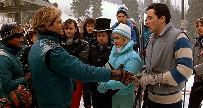 On the slopes of the K-12: (R-L) Lane Myer (John Cusack), his girlfriend Beth (Amanda Wyss), best friend Charles De Mar (Curtis Armstrong), and arrogant skier Roy Stalin (Aaron Dozier).