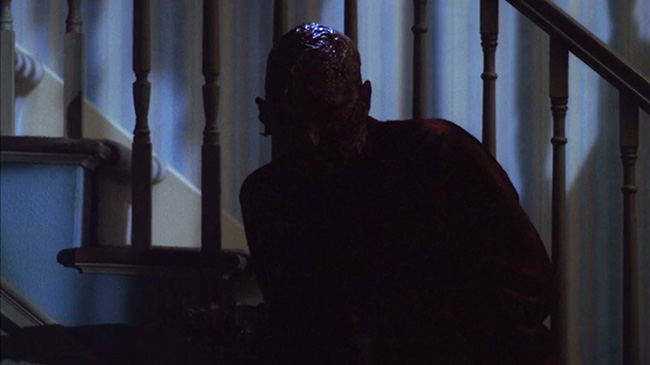 Freddy Krueger (Robert Englund) stalks Nancy in her home. Wes Craven seldom gives us a clear look at Freddy outside of shadows.