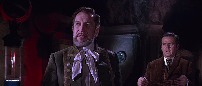 Sir Hugh (Vincent Price) shows the undersea city to Harold Tufnell-Jones (David Tomlinson).
