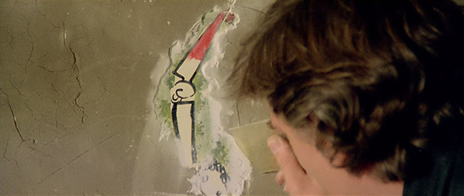 Hemmings uncovers a plastered-over child's drawing in an empty villa.