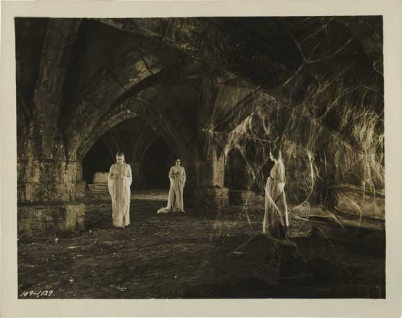 Publicity still of Dracula's wives in their crypt.