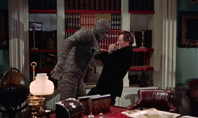 The mummy attacks John Banning.