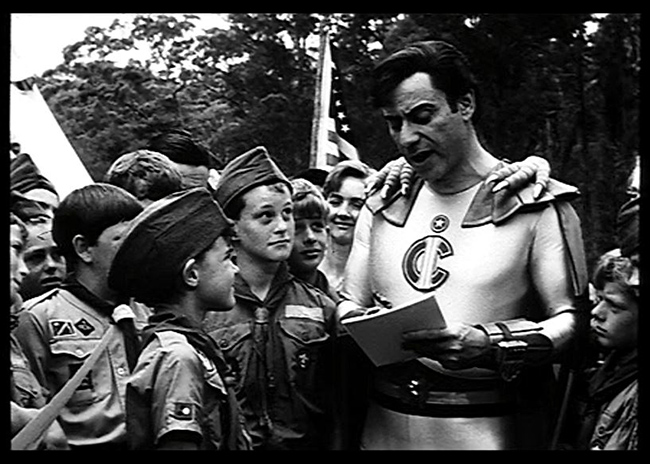 Captain Invincible (Alan Arkin) visits some boy scouts in the newsreel prologue.