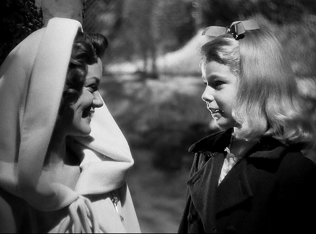 The deceased Irena (Simone Simon) offers friendship to the lonely Amy (Ann Carter).