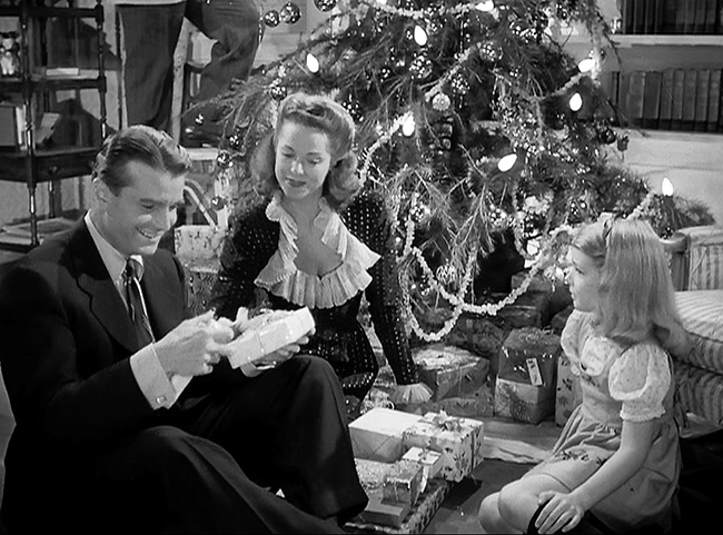 The Reed Family Christmas: Oliver (Kent Smith), Alice (Jane Randolph), and Amy.