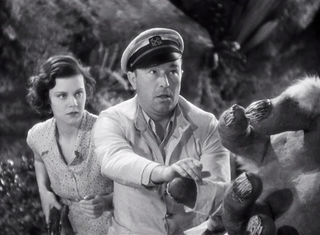 Carl Denham (Robert Armstrong) and Hilda (Helen Mack) delicately inform the Son of Kong about the death of his father.