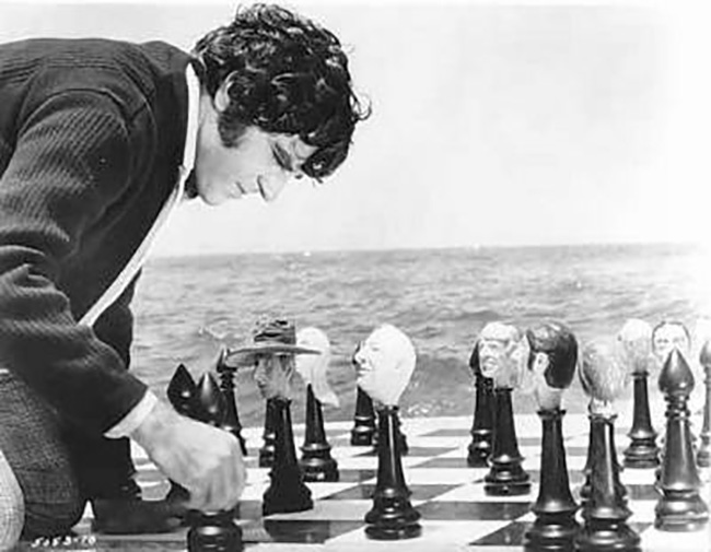 Heironymus Merkin plays chess with the figures from his past.