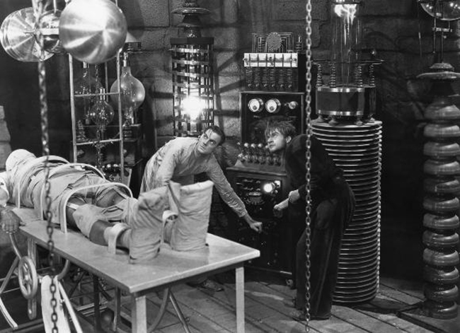 Publicity still of Henry Frankenstein (Colin Clive) and his assistant Fritz (Dwight Frye) at work on the monster.