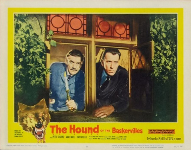 Lobby card: Dr. Watson (André Morell) and Sir Henry Baskerville (Christopher Lee) watch the moors.