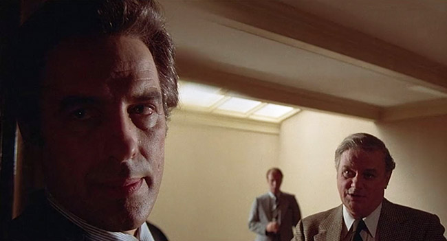 Ben Childress (John Cassavetes) meets with Dr. McKeever (Charles Durning).