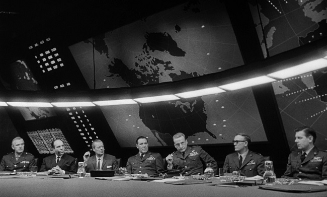 General Buck Turgidson (George C. Scott) lectures in the War Room.