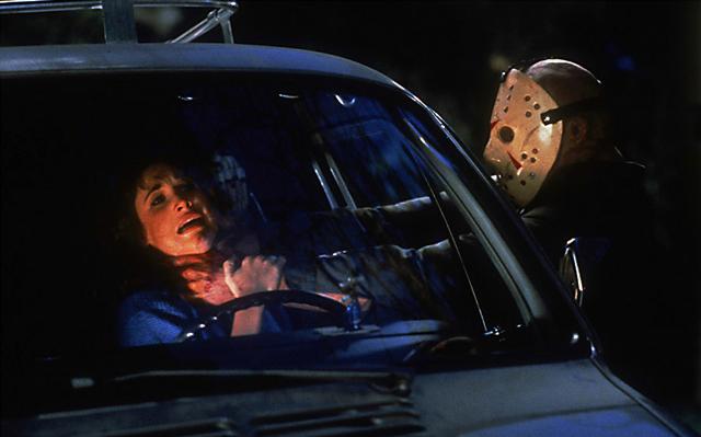 Chris (Dana Kimmell) is attacked by Jason (Richard Brooker).