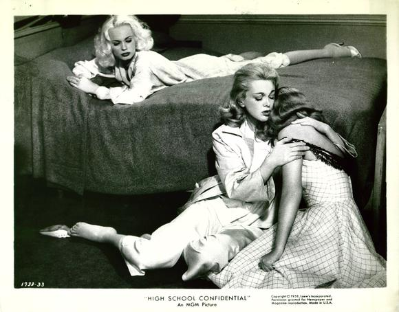 Gwen watches while Arlene (Jan Sterling) comforts young Joan (Diane Jergens).