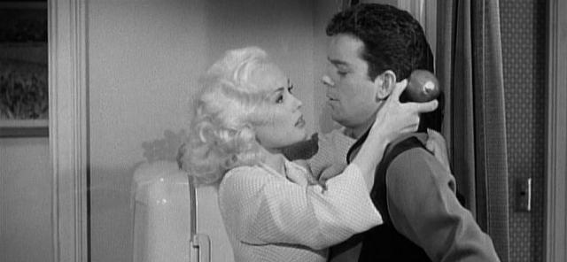 """Aunt"" Gwen (Mamie Van Doren) tries to seduce Tony."