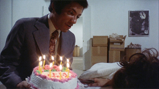 Phillip (Lisle Wilson) delivers a birthday cake to Danielle (Margot Kidder). Or is it Dominique?