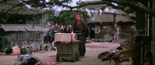 "In ""Lone Wolf and Cub: Sword of Vengeance,"" Itto Ogami (Tomisaburo Wakayama) pushes his baby cart down a road of bloody death."