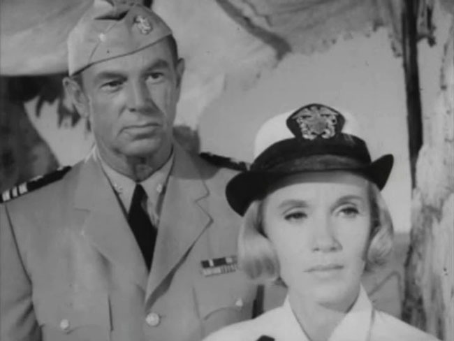 Sterling Hayden, as cold-hearted industrialist Daniel Grudge, pays a visit to Hiroshima, with Eva Marie Saint playing a Navy WAVE.