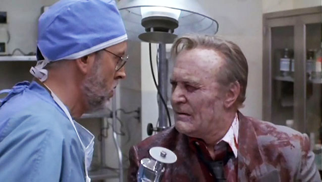 "Undead mob boss Sallie ""the Shark"" Macelli (Robert Loggia) rises to greet forensic pathologist Frank Oz."
